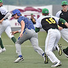 (Brad Davis/The Register-Herald) Miners infielders Justin Mitchell, left, Kyle Bergeron,right and starting pitcher Keanan Dodd (#16) work together to get Terre Haute baserunner Tucker Greer out in a rundown after he was picked off at first during the early stages of a wild game with the Rex Thursday night at Linda K. Epling Stadium.