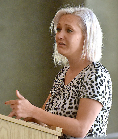 (Brad Davis/The Register-Herald) Jessica Massey, case manager for Raleigh County Community Action Association, gives an emotional speech about being a domestic violence survivor herself after receiving and Incite Hope award from the Women's Resource Center during the Love Shouldn't Hurt Community Event Saturday afternoon.