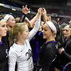 (Brad Davis/The Register-Herald) James Monroe players get fired up prior to their afternoon match against Robert C. Byrd during State Volleyball Tournament action Friday at the Charleston Civic Center.