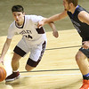 (Brad Davis/The Register-Herald) Woodrow Wilson's Bryce Radford drives to the basket past Princeton's Tanner Vaneri during Big Atlantic Classic action Friday night at the Beckley-Raleigh County Convention Center.