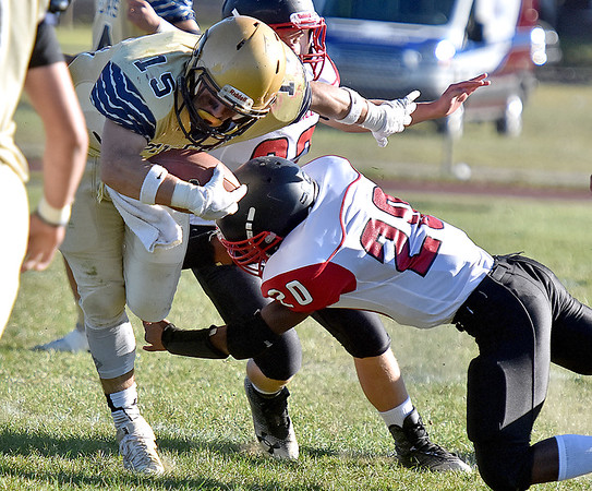 (Brad Davis/The Register-Herald) Shady Spring back Tyler Bragg tries to dodge Oak Hill defender Antwan Pagan Saturday afternoon in Shady Spring.