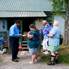 Dr. Hassan Amjad, from left, speaks with Marie Collins Buckland, who has lived in Minden for 40-years, about people she has known who have either gotten cancer or died from cancer as two other Minden residents, Thelma Phillips, who has cancer, and son passed away from cancer, and Pamela Pettry, who also has cancer, Wednesday in Minden. Buckland said all of her immediate neighbors have cancer.  Dr. Amjad is working to compile historical evidence that PCB leaked by the Shaffer Mine has caused devastating havoc on the people of the Fayette County town.