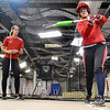 (Brad Davis/The Register-Herald) Ravenswood softball player Libby Hall, right, works on her swing mechanics with coaching help from former Marshall University and current Team USA softball player Morgan Zerkle, left, during a special clinic at the Full Count Baseball and Softball Academy Saturday afternoon in Oak Hill.