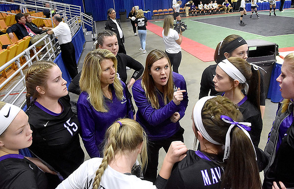 (Brad Davis/The Register-Herald) James Monroe coach Lindsay Miller (pointing) and players come together prior to their afternoon match against Robert C. Byrd during State Volleyball Tournament action Friday afternoon at the Charleston Civic Center.