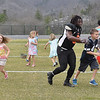 (Brad Davis/The Register-Herald) Youngsters scramble for Easter eggs as South running back Josh Robinson joins in the action during an Easter egg hunt held at halftime of a Spring League game between teams North and South Sunday afternoon in White Sulphur Springs.