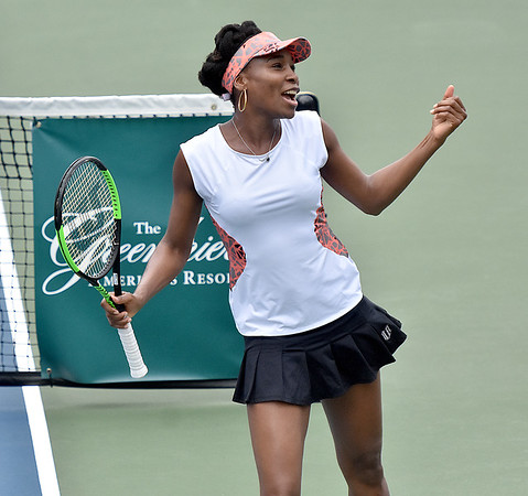 (Brad Davis/The Register-Herald) All-time tennis great Venus Williams dances to the music during a break in her match against Martina Hingis during the Greenbrier Champions Tennis Classic Saturday afternoon in White Sulphur Springs.