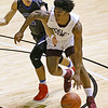 (Brad Davis/The Register-Herald) Woodrow Wilson's Isaiah Francis drives as Princeton's Cade Fix defends during Big Atlantic Classic action Friday night at the Beckley-Raleigh County Convention Center.