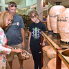 (Brad Davis/The Register-Herald) Shelby, Ohio residents, Larry Barnes, his wife Stacey and daughter Brooke browse the many artistic wares available at Tamarack Friday afternoon.