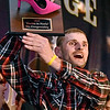 (Brad Davis/The Register-Herald) Mr. Congeniality winner David Brooks shows off his hard-earned trophy during the annual Hunks in Heels fundraising event for the Women's Resource Center Friday night at the Beckley Moose Lodge.