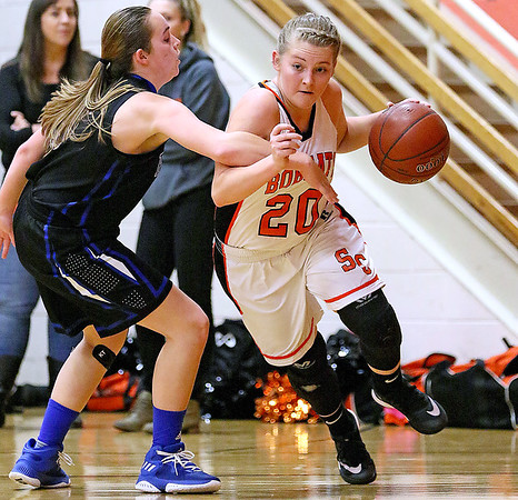 (Brad Davis/The Register-Herald) Summers County's Tiffani Cline drives to the basket along the baseline as Midland Trail's Wilson Jenny defends Thursday night in Hinton.