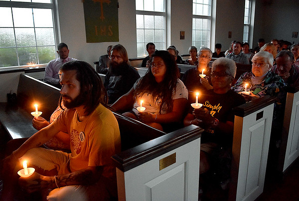 (Brad Davis/The Register-Herald) Citizens take part in a candlelight vigil for victims of hate and violence that unfolded during the weekend in Charlottesville, Va., as well victims of hate and violence around the country Wednesday night at St. Stephens Episcopal Church in Beckley. The event featured several speakers including Joan C. Browning, one of nine Albany (Georgia) Freedom Riders, and an open forum with a panel of local leaders discussing race relations and other key issues at the conclusion.