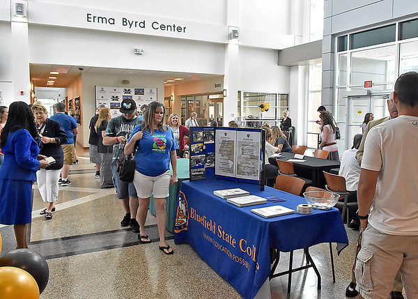 (Brad Davis/The Register-Herald) Incoming and prospective students mingle with administrators from several schools that utilize the Erma Byrd Higher Education Center during a celebration of the facility's 10-year anniversary Friday afternoon.