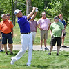 (Brad Davis/The Register-Herald) Davis Love III shoots from the rough on #17 during second round Greenbrier Classic action Friday afternoon in White Sulphur Springs.