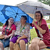 (Brad Davis/The Register-Herald) Residents (from left) Amanda Chapline, Regina Massie and Kimberly Barrett hang out despite some rain during a community picnic at Greenbrier Estates Friday afternoon. Property manager Michelle Bennett, leasing agent Phil Spurlock and other facility officials threw a cook-out style gathering with games for kids and a visit from West Virginia Miners mascot Miner Mike.