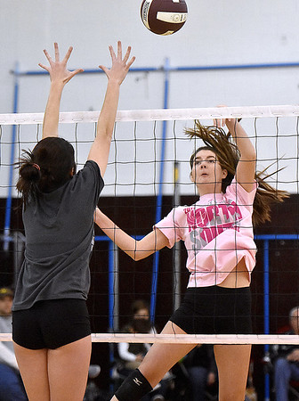 (Brad Davis/The Register-Herald) Class AA (pink) takes on Class AAA (grey) during the West Virginia North/South All-Star Volleyball event Saturday afternoon at Woodrow Wilson High School.