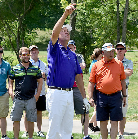(Brad Davis/The Register-Herald) Fans stand in close proximity to Davis Love III as he checks the breeze before shooting from the rough on #16 just behind the #17 tee box during second round Greenbrier Classic action Friday afternoon in White Sulphur Springs.