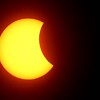 Solar eclipse at 1:35<br /> (Rick Barbero/The Register-Herald)