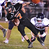 (Brad Davis/The Register-Herald) Summers County's Tucker Lilly is tripped up by Independence's Tucker Lawson Friday night in Hinton.