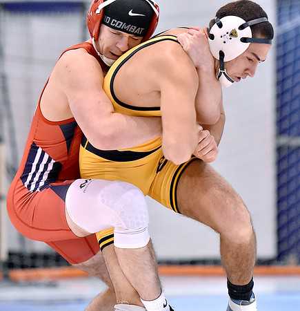 (Brad Davis/The Register-Herald) WVU Tech's Robert Pritt takes on Liberty University's Ashton Robinson in a 149-pound weight class matchup during a tri-match Saturday afternoon in Beckley.