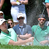 (Brad Davis/The Register-Herald) Russell Henley chips onto the #8 green from a bunker during final round Greenbrier Classic action Sunday afternoon in White Sulphur Springs.