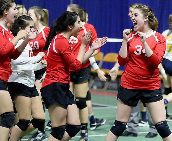 (Brad Davis/The Register-Herald) Greater Beckley Christian players celebrate follwing a win over Moorefield during State Volleyball Tournament action Friday afternoon at the Charleston Civic Center.