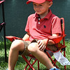 Thomas King, 5, of Columbus Ohio, watching golfers putt on the 8th hole during the second round of The Greenbrier Classic.<br /> (Rick Barbero/The Register-Herald.com
