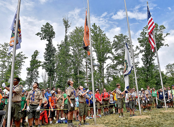 (Brad Davis/The Register-Herald) Scouts hoist flags during opening ceremonies for visiting United States Secretary of State Rex Tillerson Friday at the Bechtel Summit Reserve.