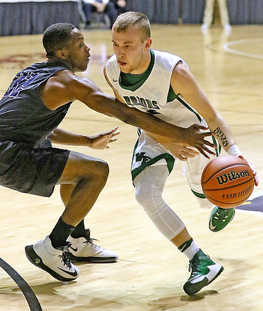(Brad Davis/The Register-Herald) Wyoming East's Jonathan Simms cuts around Independence's Markus Guy during Big Atlantic Classic action Wednesday night at the Beckley-Raleigh County Convention Center.