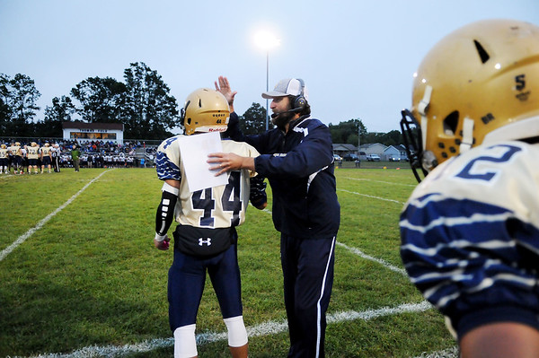 Shady Spring head coach Vince Culicerto cheers on Isaiah Valentine before kickoff during their football game against  Nicholas County Friday in Shady Spring.  (Chris Jackson/The Register-Herald)