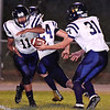 (Brad Davis/The Register-Herald) Greenbrier West's Mylik Cox gets the handoff from teammate Chad Ramsey Friday night in Hinton.
