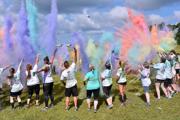 (Brad Davis/The Register-Herald) All participants form a massive circle and launch colored strach in the air following the United Way of Southern West Virginia's annual Color Me United Walk/Run Saturday afternoon at the Raleigh County Memorial Airport.