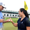 Davis Love III, left, signs a golf ball for Mary Denny on the 18th green after the First Tee Scramble held on the Old White course at The Greenbrier.<br /> (Rick Barbero/The Register-herald)