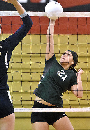 (Brad Davis/The Register-Herald) Fayetteville's Whimzey Gipson spikes the ball as Nicholas County's Anna Hamilton tries to block it during a volleyball match at Liberty High School Wednesday night.