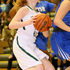 (Brad Davis/The Register-Herald) Wyoming East's Megan Davis drives to the basket as St. Joseph Central's Tyesha Taylor (behind Davis) defends during the Lady Warriors' win over the Irish Friday night in New Richmond.