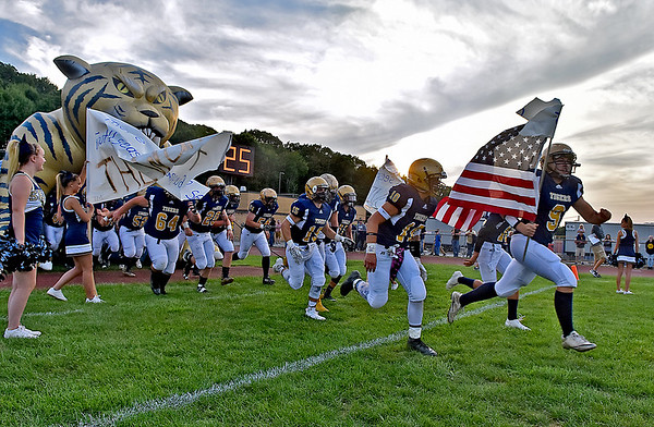(Brad Davis/The Register-Herald) The Shady Spring Tigers take the field for their game against Lincoln County Friday night in Shady Spring.