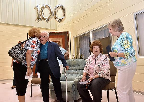 (Brad Davis/The Register-Herald) Harlan Mann's 100th birthday party at Beckley Regular Baptist Church Saturday evening.