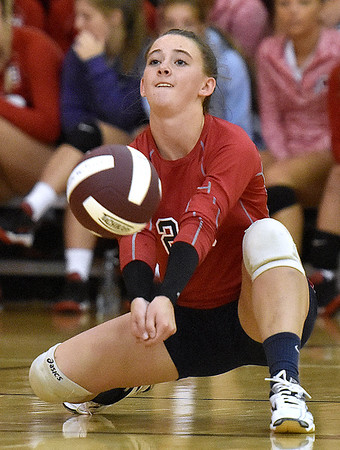 (Brad Davis/The Register-Herald) Independence's Nicole Kester drops down to return the ball against Cabell Midland during the Shirley Brown Invitational Volleyball Tournament Saturday afternoon at Woodrow Wilson High School.