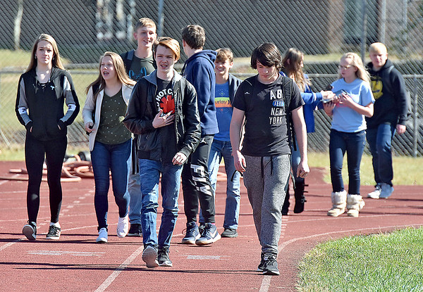 (Brad Davis/The Register-Herald) Independence High School students walk the school's track in memory of late teacher Kim Campbell, who passed away at the school recently, Wednesday afternoon in Coal City. Every student in the school donated a dollar and walked for one hour in her honor. Proceeds will create the Kim Campbell Scholarship Fund.