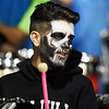 Oak Hill band member Mason Young is dressed for Halloween during their high school football game against Midland Trail Friday in Hico. (Chris Jackson/The Register-Herald)