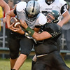 (Brad Davis/The Register-Herald) Westside quarterback Travis Cook is taken down by Wyoming East's       Isaac Perdue Friday night in New Richmond.