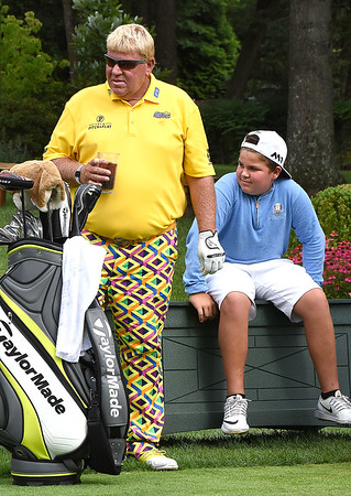 John Daly waits on the 12th tee box with his son John Daly Jr. during the first round of The Greenbrier Classic.<br /> (Rick Barbero/The Register-Herald.com