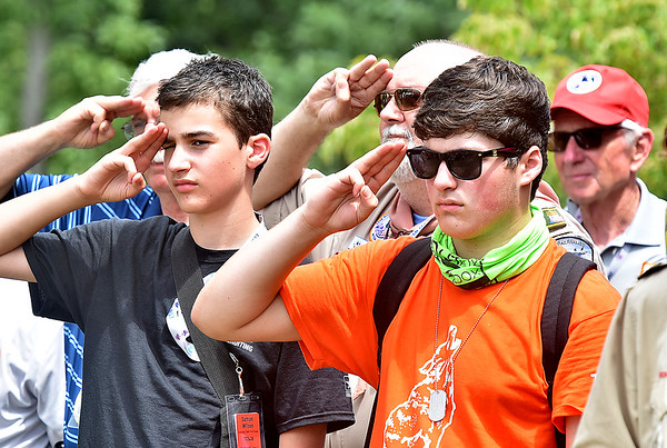 (Brad Davis/The Register-Herald) Scouts of all ages salute during opening ceremonies for visiting United States Secretary of State Rex Tillerson Friday at the Bechtel Summit Reserve.