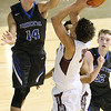 (Brad Davis/The Register-Herald) Princeton's Cade Fix steps up to try and stop a drive by Woodrow Wilson's Eddie Christian during Big Atlantic Classic action Friday night at the Beckley-Raleigh County Convention Center.