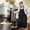 Paul Plumley mixes up some dough at the Donut Connection<br /> (Rick Barbero/The Register-Herald
