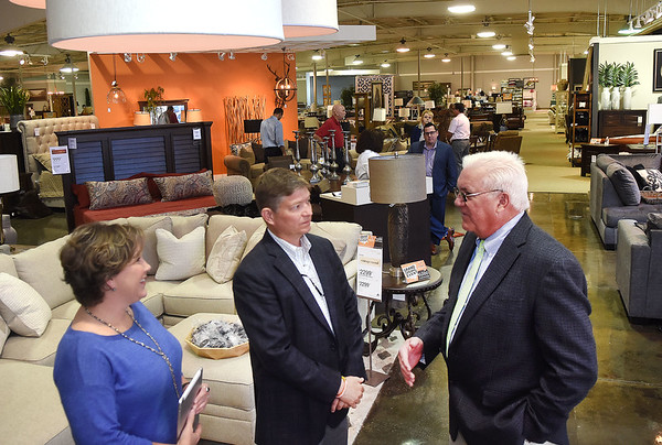 Monra Featers, director of marketing and Bob Young, owner Ashley Homestore, speaks with Beckley City mayor Rob Rappold during the stores Grand Opening on Eisenhower Drive in Beckley Friday afternoon. <br /> (Rick Barbero/The Register-Herald