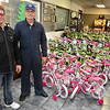 (Brad Davis/The Register-Herald) Magnum Carwash owners Allen Sargent, left, and Dale Brady pose for a quick photo with 117 bicycles to be given away this Christmas as part of Toys for Tots during a free car wash and charity event at their Eisenhower Drive location Saturday morning.