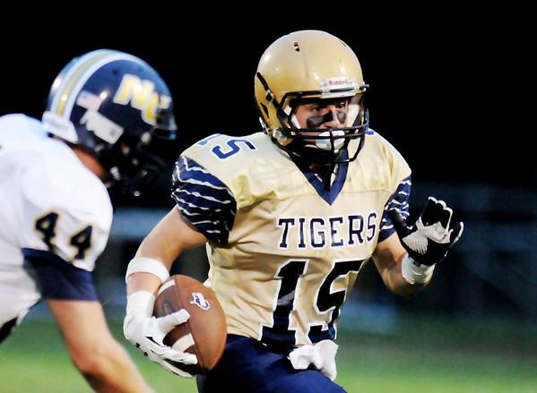 Shady Spring's Tyler Bragg (15) runs past Nicholas County's D.J. McCutcheon during their high school football game Friday in Shady Spring.  (Chris Jackson/The Register-Herald)
