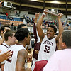 (Brad Davis/The Register-Herald) Woodrow Wilson's Breland Walton (#52) hoists the plaque as he and teammates celebrate following the Flying Eagles' Sectional Championship victory over Greenbrier East Friday night at the Beckley-Raleigh County Convention Center.