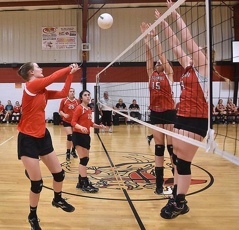 (Brad Davis/The Register-Herald) Greater Beckley Christian's Courtney Green, left, returns the ball as Ravenswood's Kasey Hoff (#15) and Katie Mellinger try to block Saturday afternoon in Prosperity.
