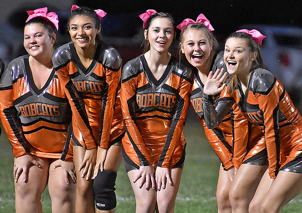 (Brad Davis/The Register-Herald) A group of Summers County cheerleaders notice the camera prior to the Bobcats' home game against Independence Friday night in Hinton.